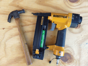 A small hammer or a brad nailer can be used to assemble frames, but a heavier hammer will be necessary to assemble the heavier hive parts.