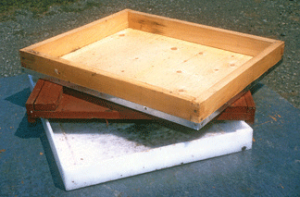 Wooden hive tops with metal covers are commonlyused by hobby beekeepers. To delay rotting causedby rain and moisture, a wooden rimmed hive covershould be painted occasionally. A flat board cover is a simpler and cheaper top, but nonetheless functional. Plastic covers are essentially maintenance free, but will sometimes warp or bow. Over time, plastic and expanded polystyrene tops will begin to degrade. Ironically, painting plastic equipment will help forestall weather induced degradation.